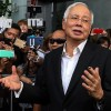Almost $30 million, 400 handbags seized in raids linked to Malaysia's ousted leader Najib Razak