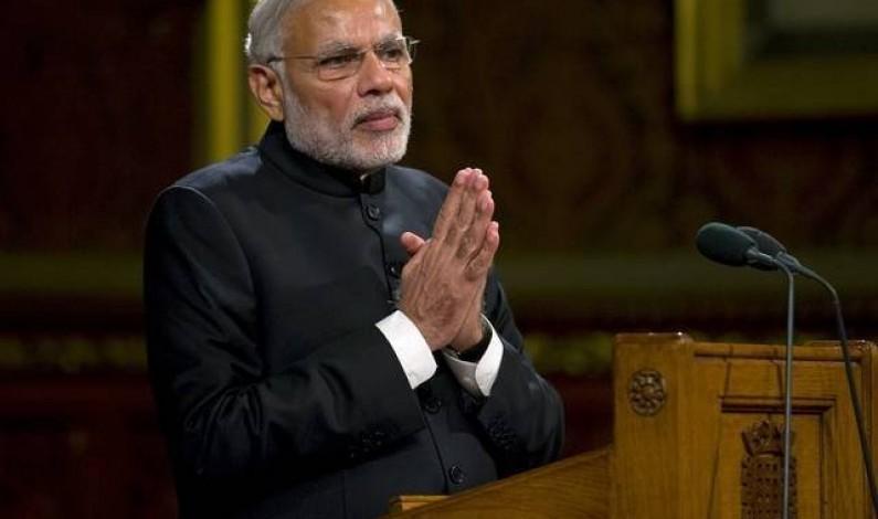 India's Modi sails through confidence vote with rival's embrace