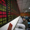 Asian markets mostly down on China tariff fears