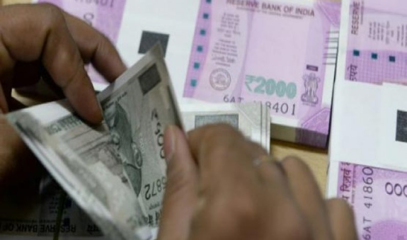 India's rupee hits new record low as RBI holds rates