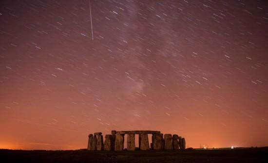 Meteor streaks past stars