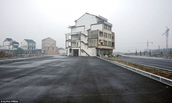 House middle of road