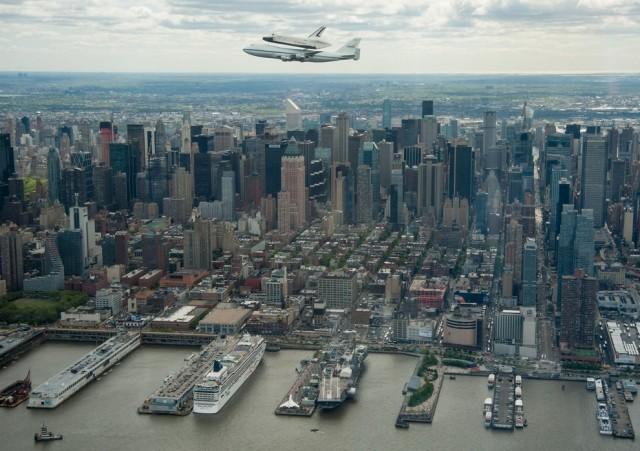 The Space Shuttle Enterprise flying above New York City