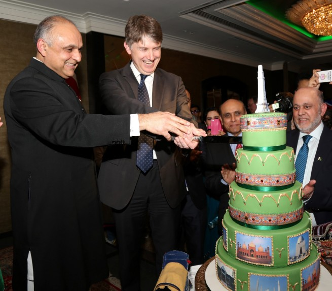 Syed Ibne Abbas, Pakistan High Commissioner to the UK and Mr Owen Jenkins, Prime Minister's Special Representative on Afghanistan and Pakistan cutting cake at the Pakistan Day Reception in London on 23-3-201