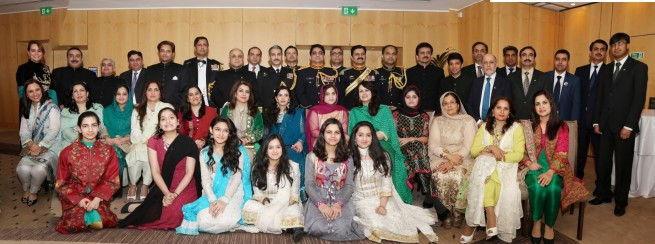 Officials and their families in a group photo with Syed Ibne Abbas, Pakistan High Commissioner to the UK at the Pakistan Day Reception in London on 23-3-201