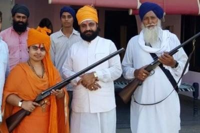 Gun-loving India 'god-woman' who shot wedding guests
