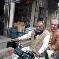 Shah Mehmood Qureshi takes a motorcycle ride through his constituency