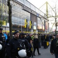 Police patrol outide the stadium after the team bus of Borussia Dortmund had some windows broken by an explosion some 10km away from the stadium prior to the UEFA Champions League 1st leg quarter-final football match BVB Borussia Dortmund v Monaco in Dortmund, western Germany on April 11, 2017. PHOTO: AFP