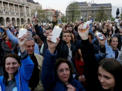 People light with their mobile phones as they protest against the bill that would undermine Central European University, a liberal graduate school of social sciences founded by U.S. financier George Soros in Budapest, Hungary, April 9, 2017. PHOTO: REUTERS