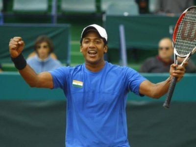 India's Mahesh Bhupathi celebrates after he and his teammate Leander Paes (unseen) won the Davis Cup doubles tennis match against Romania's Adrian Cruciat and Horia Tecau in Bucharest. PHOTO: REUTERS