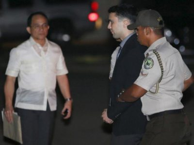 Philippine Bureau of Corrections personnel escort U.S. Marine Lance Corporal Joseph Scott Pemberton (C), after he was found guilty by trial court of killing Jennifer Laude, a transgender woman, upon arrival in a detention facility at Camp Aguinaldo in Quezon city, Metro Manila. PHOTO: REUTERS