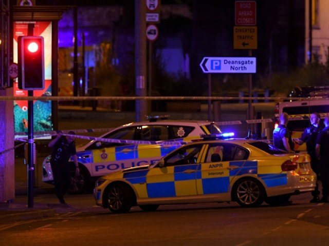 Police deploy at scene of explosion in Manchester, England, on May 23, 2017 at a concert. PHOTO: AFP