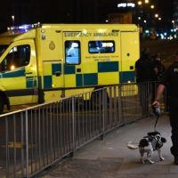Emergency response vehicles arrive at the scene of a suspected terrorist attack during a pop concert by US star Ariana Grande in Manchester, northwest England on May 23, 2017. PHOTO: AFP