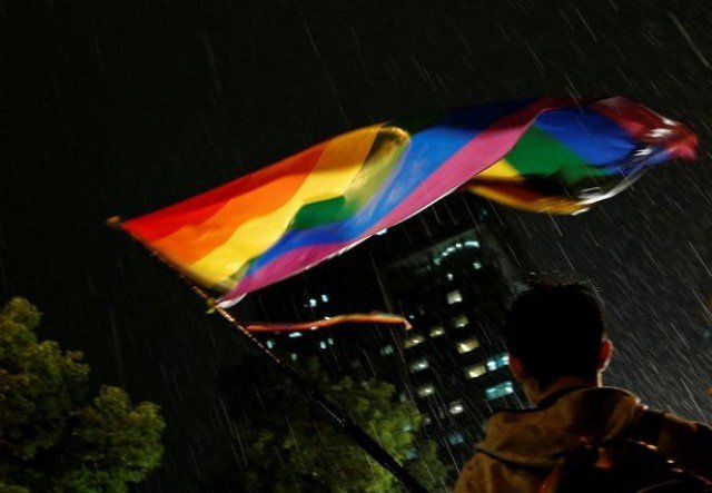 A supporter waves a rainbow flag during a rally after Taiwan's constitutional court ruled that same-sex couples have the right to legally marry, the first such ruling in Asia, in Taipei, Taiwan May 24, 2017. PHOTO: REUTERS