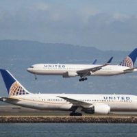A United Airlines aircraft taxis as another lands at San Francisco International Airport, San Francisco, California. PHOTO: REUTERS