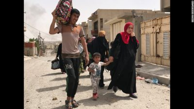 Residents flee an ISIS-controlled neighborhood in Mosul.