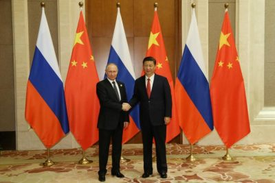 Russian President Vladimir Putin (L) shakes hands with Chinese President Xi Jinping ahead of a bilateral meeting at Diaoyutai State Guesthouse in Beijing, China, 14 May 2017. REUTERS/Wu Hong/Pool