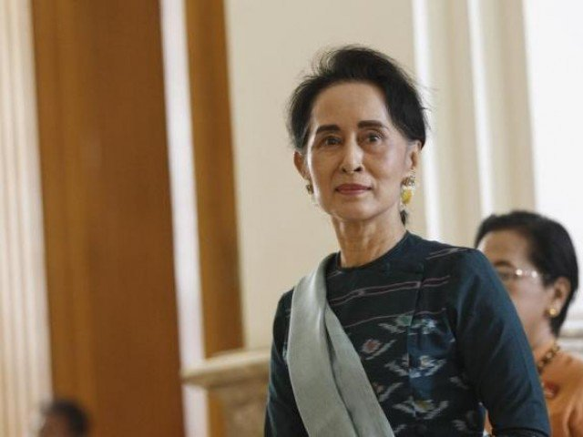National League for Democracy (NLD) party leader Aung San Suu Kyi arrives at the Union Parliament in Naypyitaw, Myanmar March 15, 2016. PHOTO: REUTERS