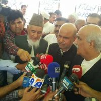 Opposition, leader, NA, Syed Khursheed Shah, is, talking, to, media, after, visit, Protest, camp, settled, by, FATA, Parliamentarians, to, merge, FATA, in, KP,