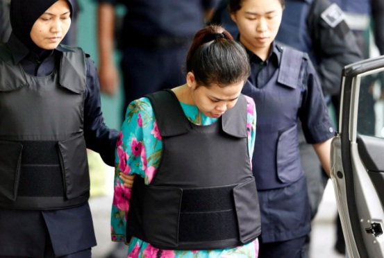 Indonesian Siti Aisyah who is on trial for the killing of Kim Jong Nam, the estranged half-brother of North Korea's leader, is escorted as she leaves at the Department of Chemistry in Petaling Jaya, near Kuala Lumpur, Malaysia. REUTERS