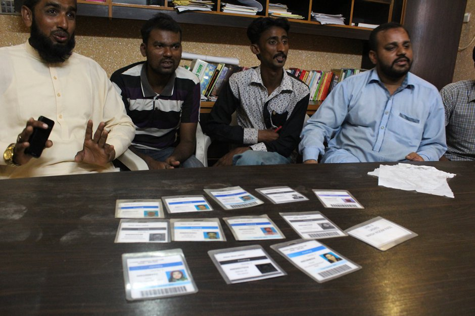 The sacked workers with their cards, cut by half, sharing their experiences at the sweatshop of H&M manufacturing