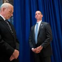 White House Chief of Staff John Kelly, left, looks at the floor at Trump Tower in New York on Aug. 15 as President Donald Trump addresses a violent confrontation over Confederate memorials in Charlottesville, Virginia
