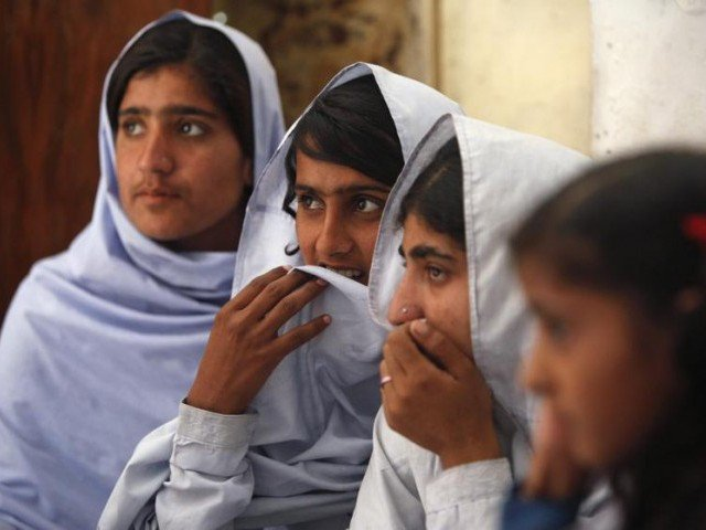 Students react while attending a lecture on preventive measures to take when sexual harassment occurs, during a class in Shadabad Girls Elementary School in Pir Mashaikh village in Johi, some 325km from Karachi February 12, 2014. PHOTO: REUTERS