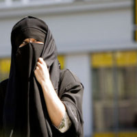 Denmark bans Islamic full-face veil in public spaces