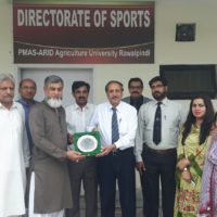 Vice Chancellor Arid University Prof. Dr Sarwat Naz Mirzi presenting a sheild on retirement of Director sports AGHA Saleem Khliji almaroof peer agha ji sarkar