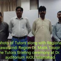 Regional Director AIOU Rawalpindi Region Dr. Malik Tauqir Ahmad Khan addressing the Tutors Briefing ceremony at Dr. W Monday. Zaki Auditorium AIOU Islamabad on Sunday