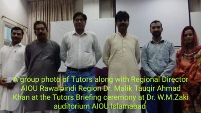 Regional Director AIOU Rawalpindi Region Dr. Malik Tauqir Ahmad Khan addressing the Tutors Briefing ceremony at Dr. W Monday. Zaki Auditorium AIOU Islamabad on Sunday